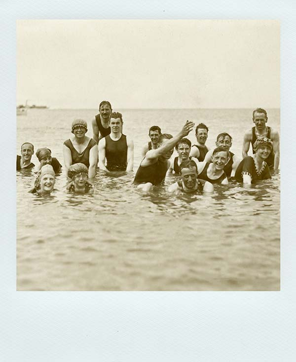 Old photo of people in the ocean - A Collective approach to problem solving